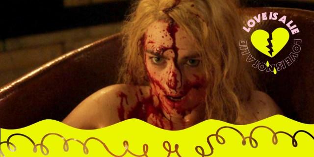 Katie McGrath bloody in a bathtub.