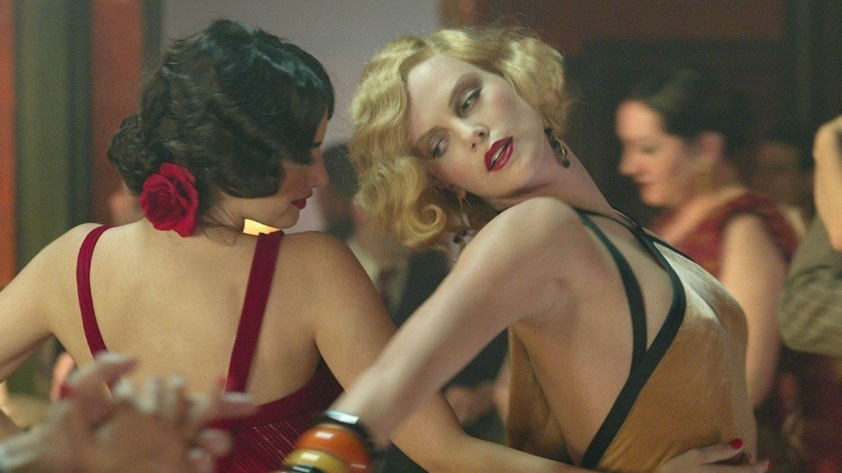 """Charlize Theron in a sexy outfit dancing in """"Head in the Clouds"""""""