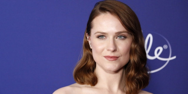A red carpet photo of Evan Rachel Wood with shoulder-length red hair