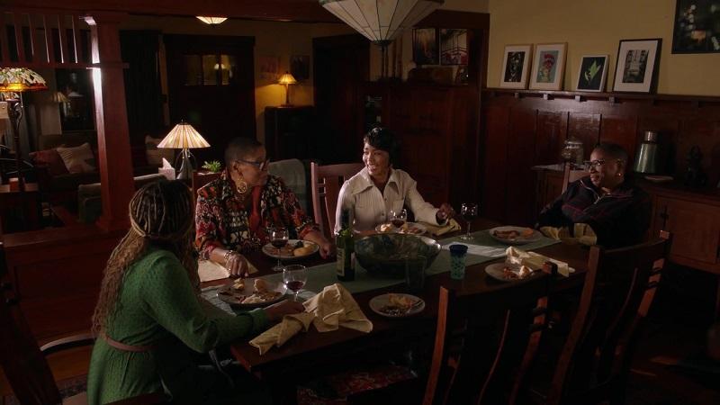 Karen, Athena, Hen and Hen's mother enjoy family dinner together.