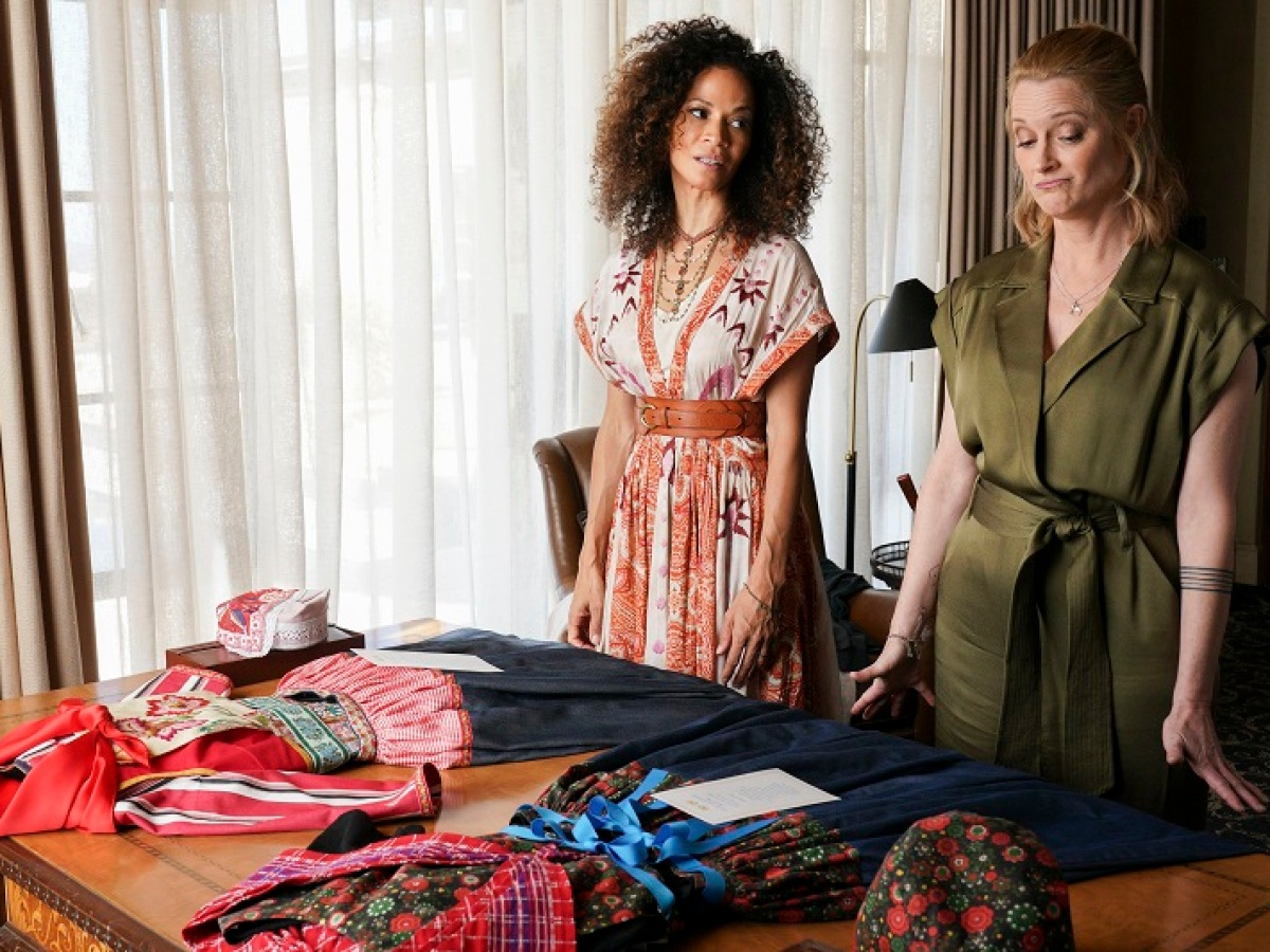 Stef and Lena take a look at their outfits for the night's festivities.