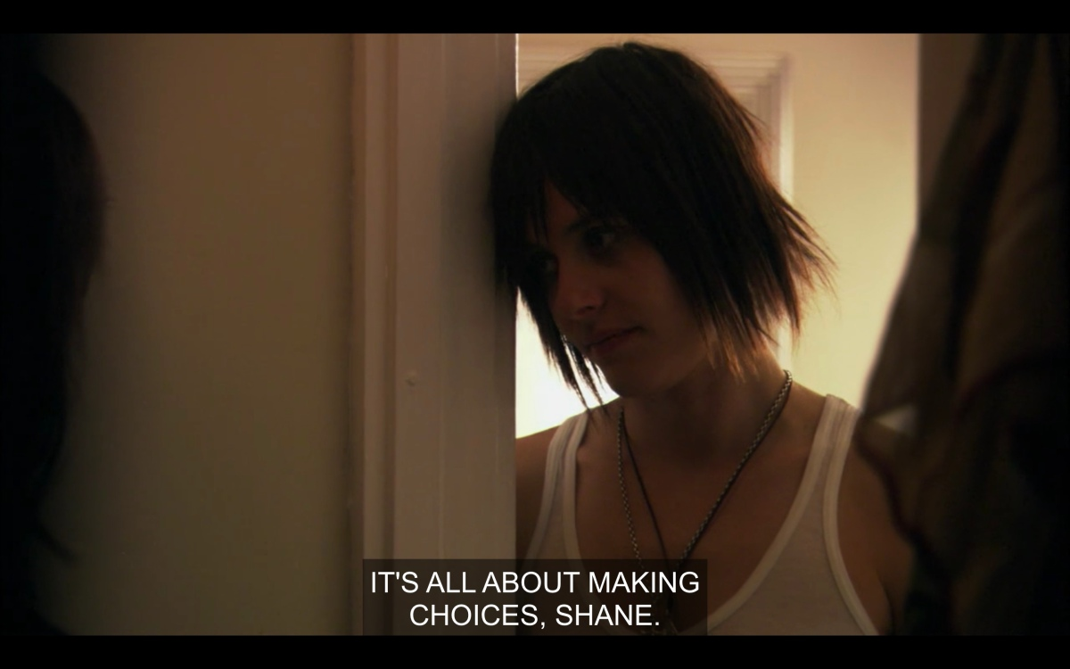 Shane leaning on the closet door while Jenny tells her to make choices