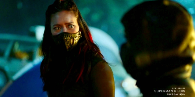 Grace Choi is prepared for a fight, she's disguised herself with red hair and green cat eyes and an inordinate black mask.