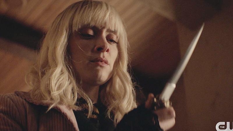 Alice holding a knife