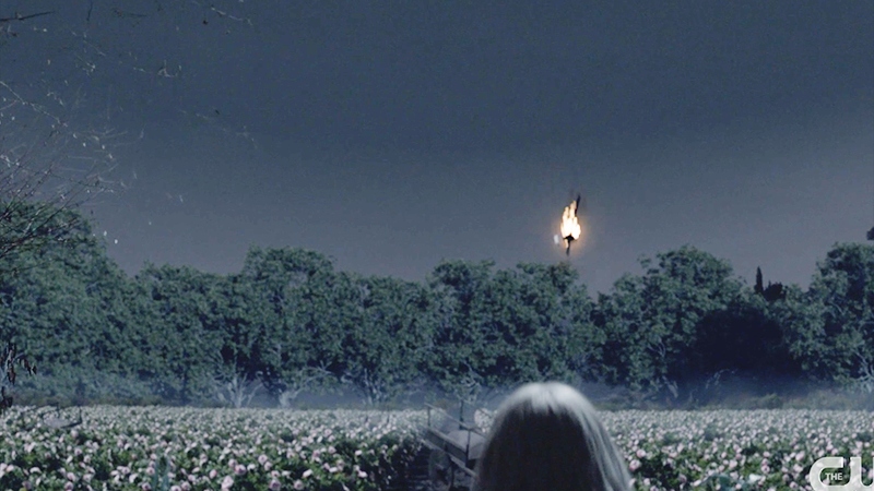 Flaming torch over field