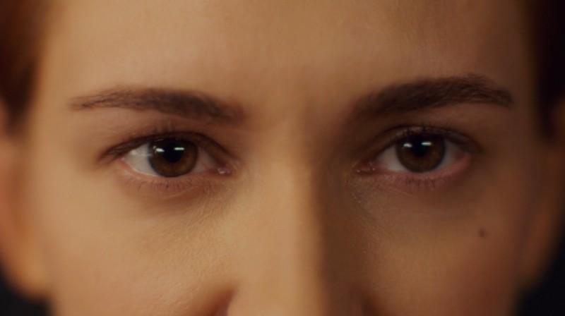 Close-up of Nicole's eyes returning Wynonna's gaze