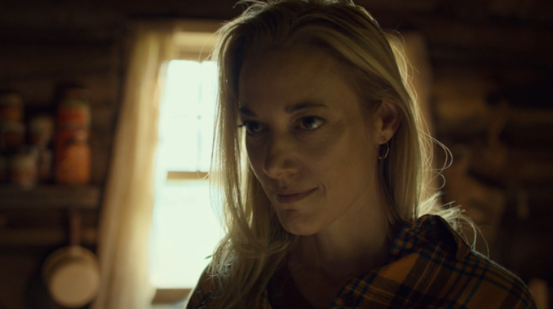 Jolene smiles wickedly at Waverly from the shadows.