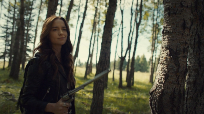 Wynonna and Peacemaker in the forest