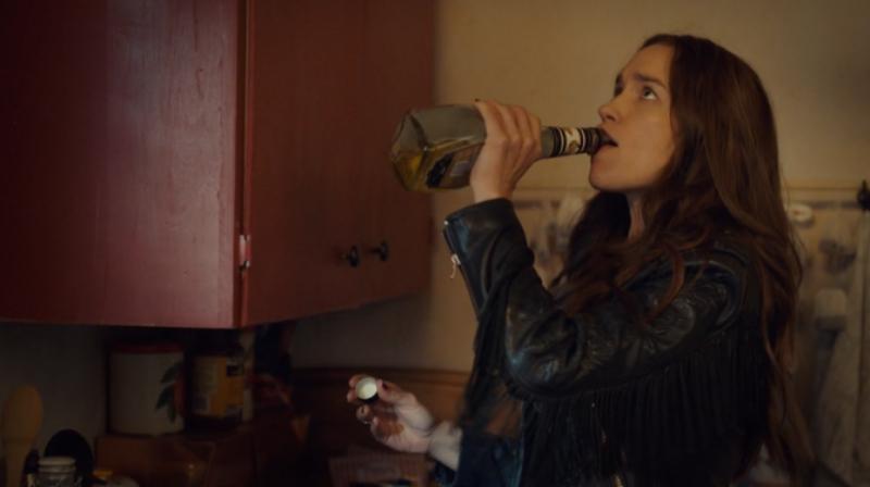 Wynonna takes a swig of banana liqueur