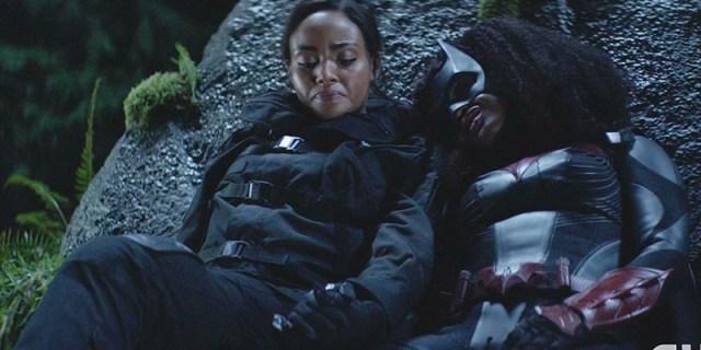 Batwoman lays her head on Sophie's shoulder.