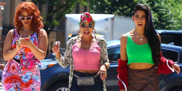 Dascha Polanco, Daphne Rubin-Vega, and Stephanie Beatriz walk across the street in the In The Heights Trailer