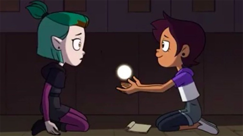 Luz and Amity sit together with a ball of light between them