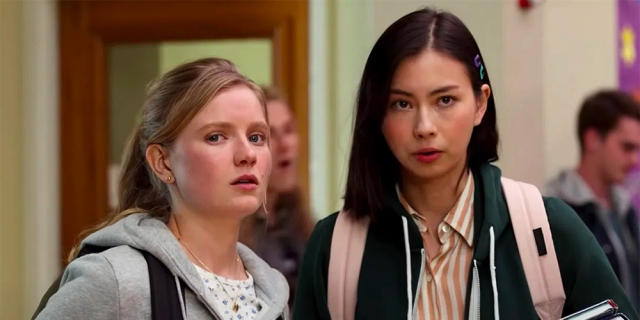 Moxie Review: Hadley Robinson and Lauren Tsai stand together in the hallway of their school.