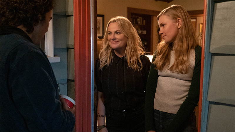 Moxie Review: Hadley Robinson and Amy Poehler stand in the doorway.