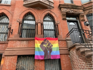brownstone with rainbow flag + fist