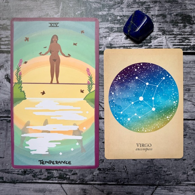 A photo of the tarot card for Temperance and the astrological card representing Virgo, along with a small crystal
