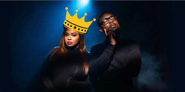 """The comedy duo Crissle West and Kid Fury of the podcast """"The Read"""" are against a navy blue and black background, a gold crown has been photoshopped onto Crissle's head."""