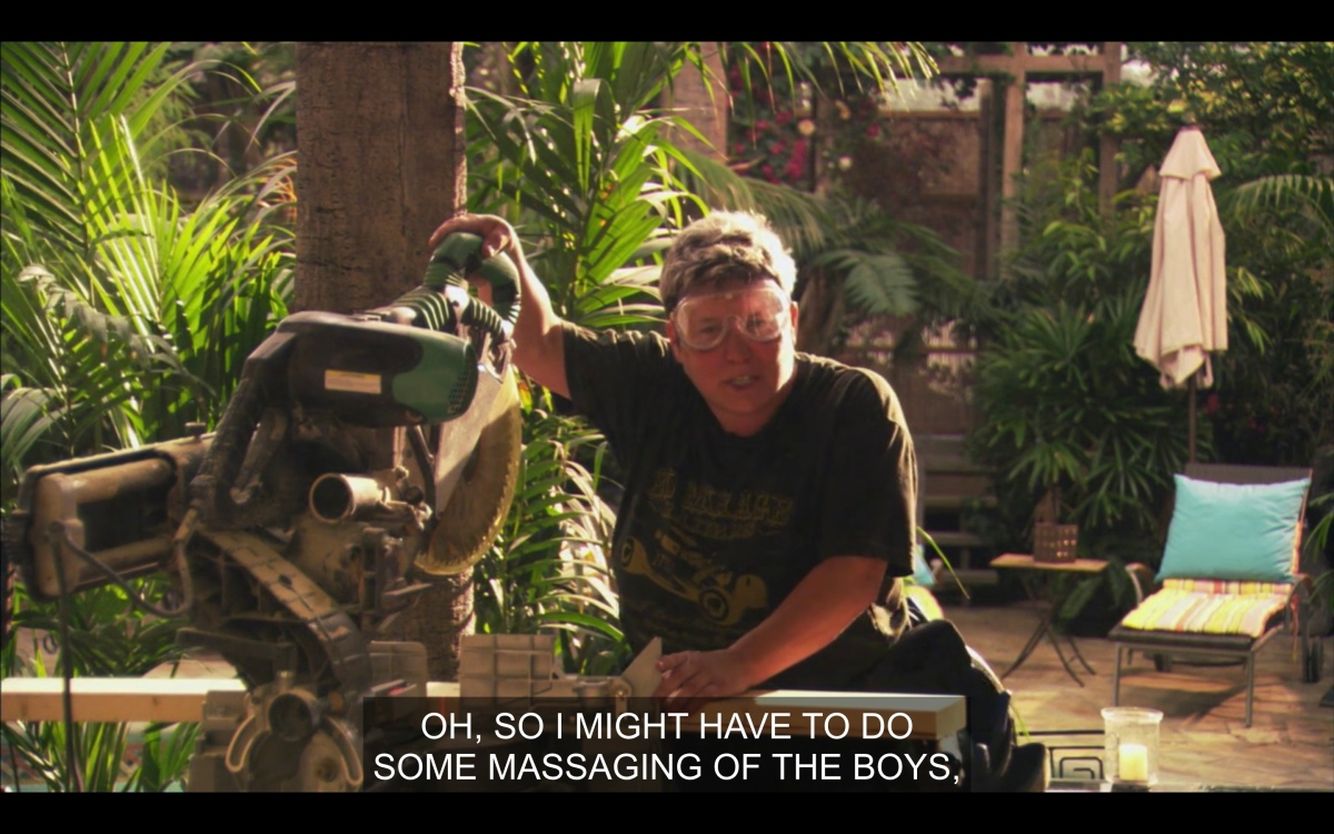 """Bette & Tina's butch construction worker is doing something with a chainsaw and talking about """"massaging the boys"""""""