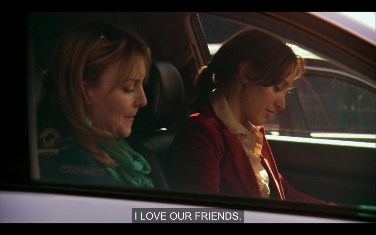 """Bette and Tina in the front seat of their car talking about moving, Bette says """"i love our friends"""""""
