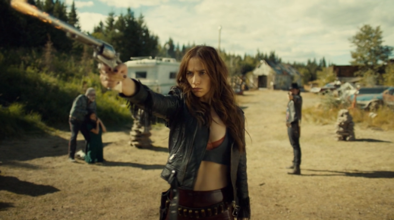 Wynonna holds Peacemaker up to shoot.