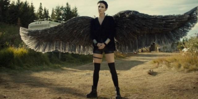 Dark Angel Waverly stands proud, wings spread.