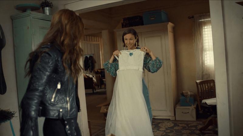 Wynonna Earp series finale recapWaverly holds up her wedding dress for Wynonna.