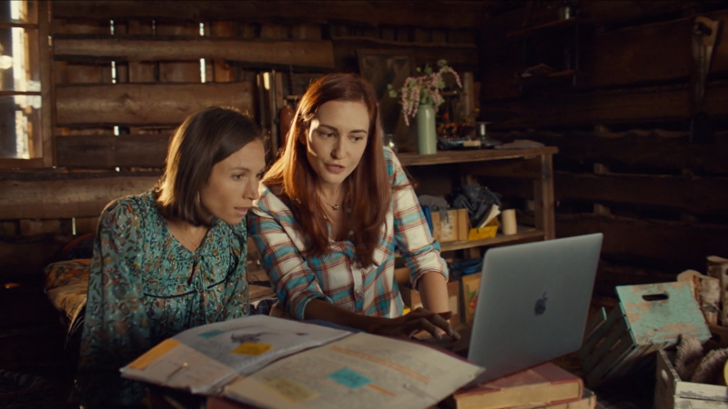 Wynonna Earp series finale recap: Nicole and Waverly look at a laptop together.