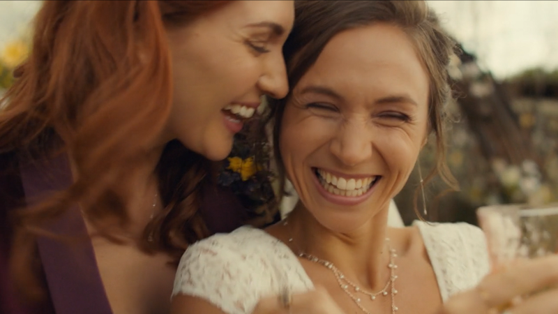 Waverly and Nicole laugh and are visibly in love.