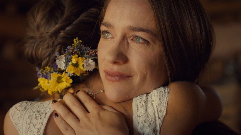Wynonna Earp series finale recap: Wynonna holds Waverly tight, tears in her eyes and a smile on her lips.
