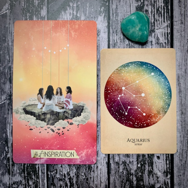 A tarot card for the 4 of Inspiration, featuring four female figures seated on a stone platform clasping hands and meditating or praying; a constellation card reading Aquarius: Sense; and a teal crystal