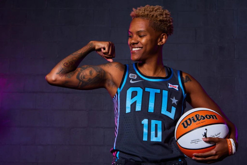 The Atlanta Dream's Courtney Williams shows off the new Rebel Edition jersey.
