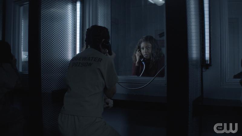 angelique facing ryan talking through prison glass