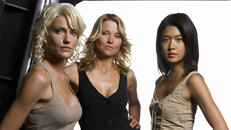 Tricia Helfer as Six, Lucy Lawless as D'Anna Biers, and Grace Park as Boomer