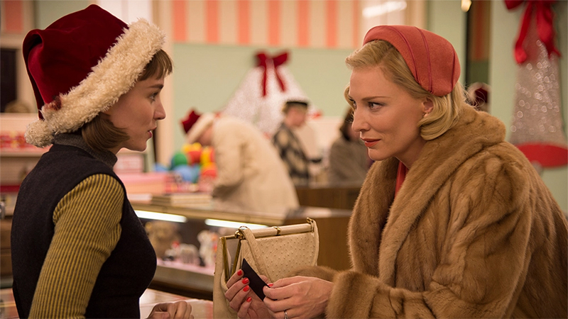 Good First Date Movies for Lesbians: Carol and Therese share a moment in a department store