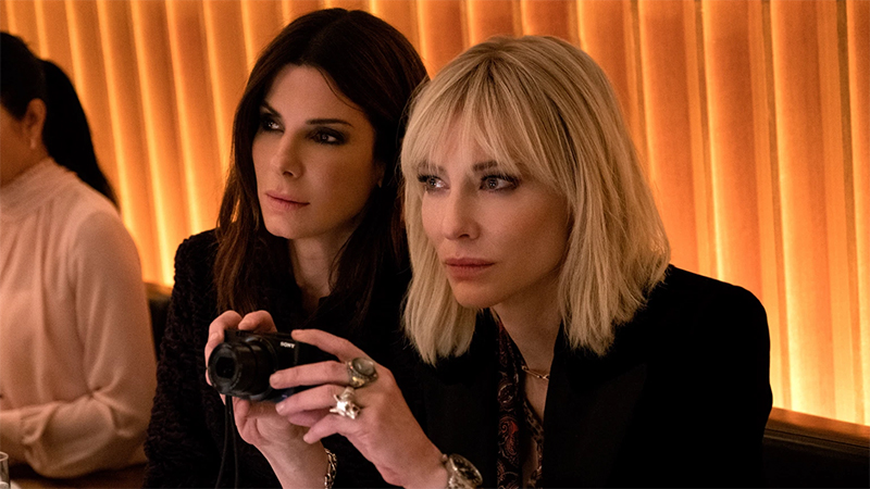 Cate Blanchett and Sandra Bullock sit together in Ocean's 8