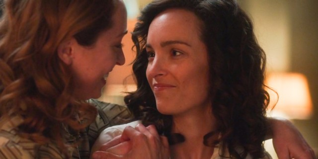 For All Mankind lesbians Ellen looks lovingly at Pam, who has a hand on her shoulder and is returning her smile