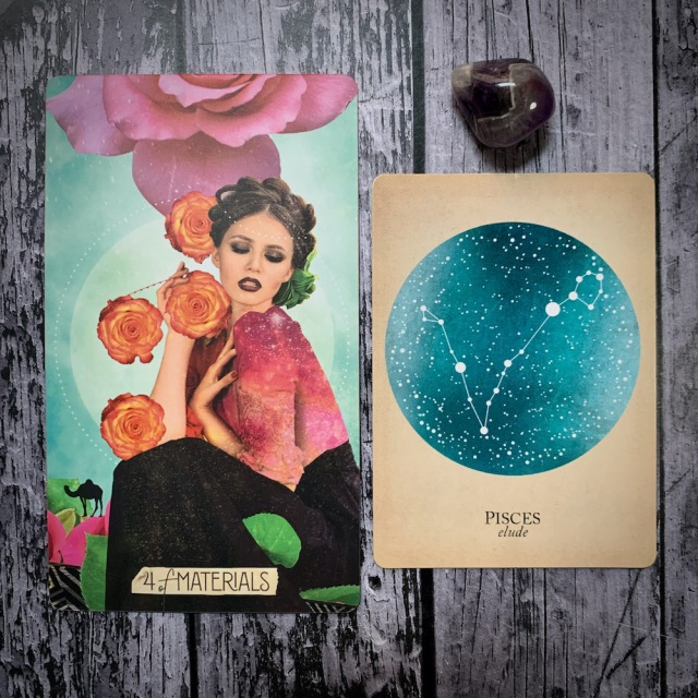 A tarot card for the 4 of Materials, featuring a woman in glamorous makeup clutching four blooming roses sensually; a constellation card reads Pisces: Elude, with a vareigated gray and black crystal