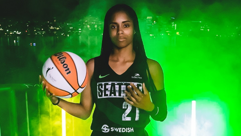 Storm guard Jordin Canada shows off Seattle's new Rebel Edition jersey.