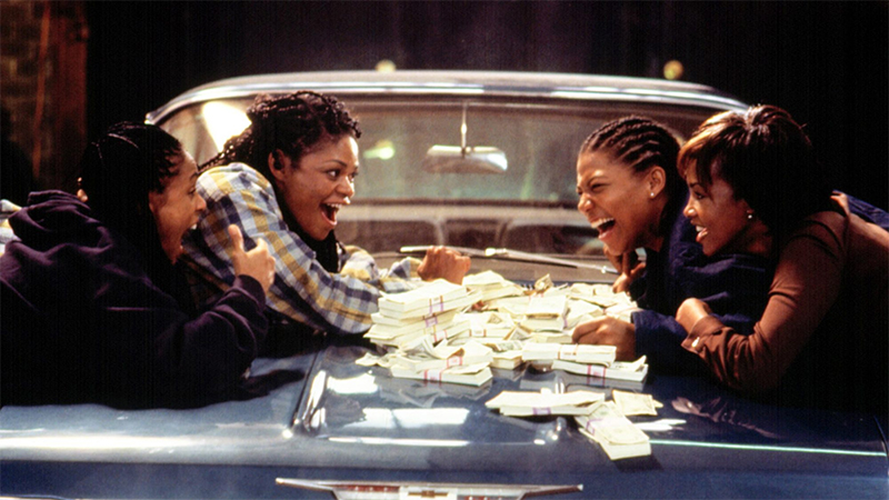 The women of Set It Off count their money on the hood of a classic car