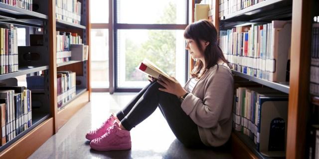 reading among bookshelves
