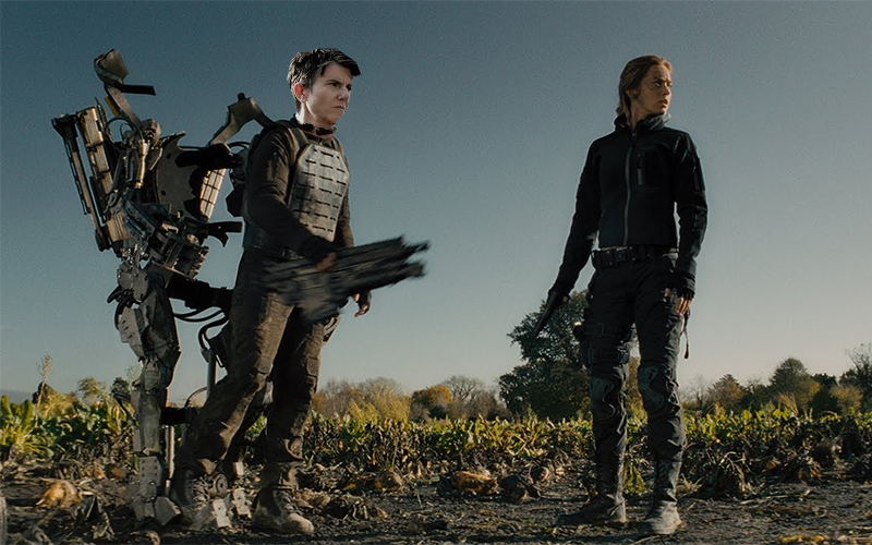 Tig Notaro Photoshopped into The Edge of Tomorrow with Emily Blunt, wearing a robotic suit