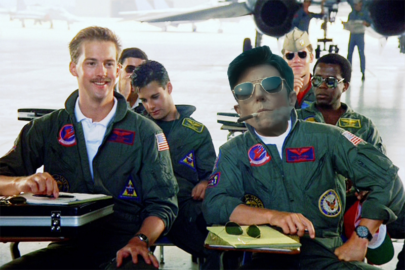 Tig Notaro Photoshopped into Top Gun wearing in aviators and a flight jump suit