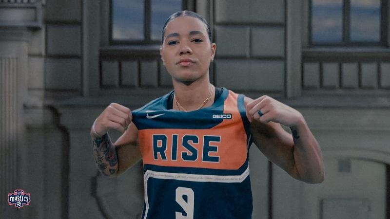 Mystics Guard Natasha Cloud shows off Washington's new Rebel Edition jersey.