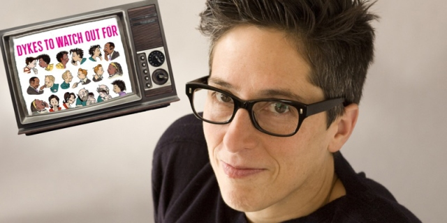 "Alison Bechdel is against a white background in a black t shirt and black glasses. Next to her is a cut out of a television set with the cover of ""Dykes to Watch Out For"" photoshopped inside of it"