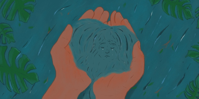 A pair of brown hands scoop up water, within the dark turquoise pool gathering in the palms is the reflection of a face.