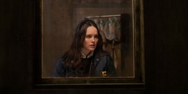 Rebecca Breeds as Clarice Starling wearing her FBI jacket is framed in a mirror