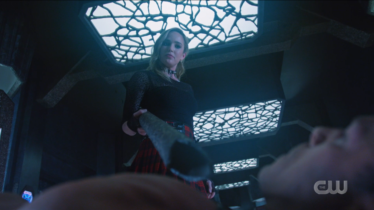Ava points her weapon down at Spartacus.