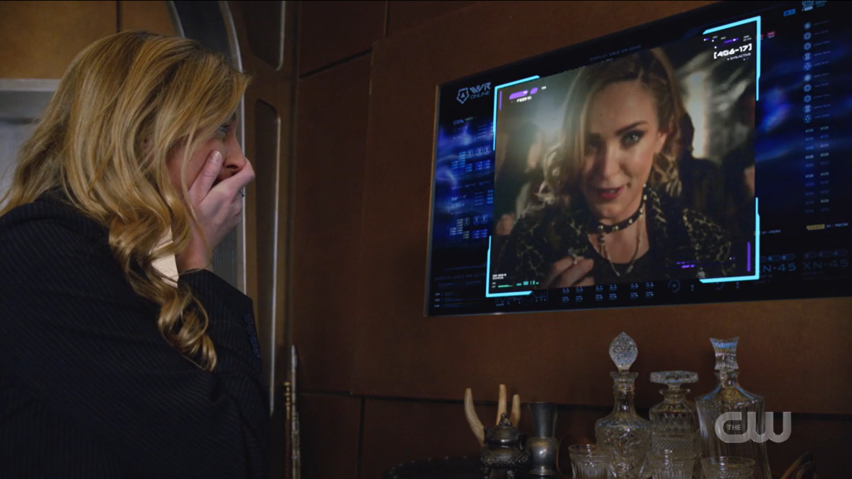 Legends of Tomorrow recap: Ava covers her face in joy as she watches the footage of Sara talking about proposing.