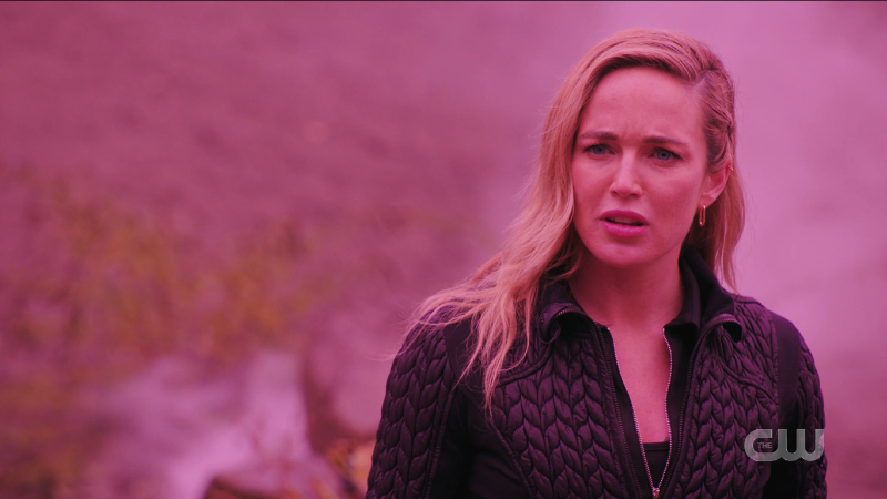legends of tomorrow 602 recap: Sara is washed in a pink light as she looks at Amelia incredulously.