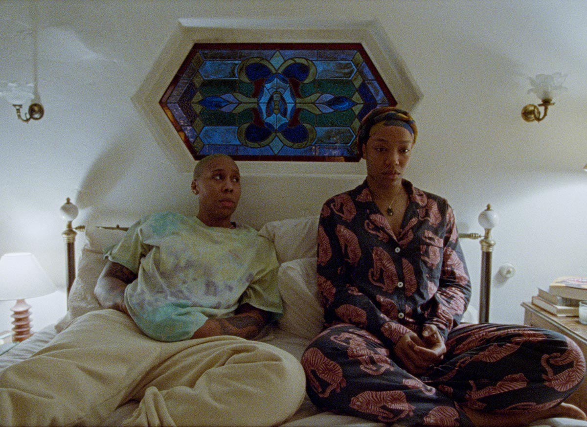 Lena Waithe in the third season of Master of None as Denise. She sits in bed with her wife at night.
